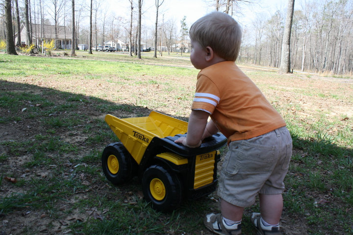 Bryson pushing his Tonka Dump Truck at 16 months old.